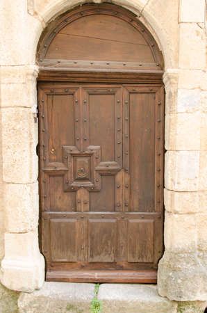old wooden door of a house in Provence, France