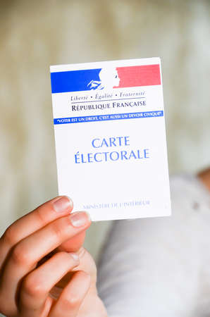 woman holding a french election card