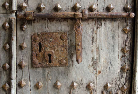 old lock on a studded wooden door