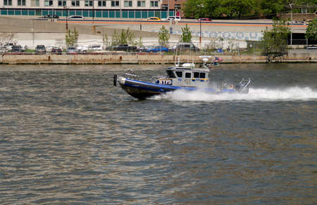 New York City, USA - May 07, 2015: New York Police Department speedboat patrolling around Manhattan Editorial