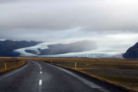 The ring road in Iceland with a glacier as the backdrop.