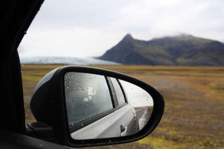 Exterior Rear-view mirror and a glacier as backdrop in Iceland.