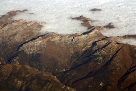 The cloudy Alps when flying over them. 版權商用圖片