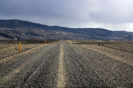 Straight to infinity on a sandy road, Iceland.