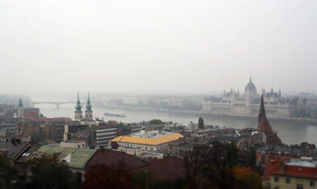 View of Budapest in a blurry raining day. Parliament building and Danube river.