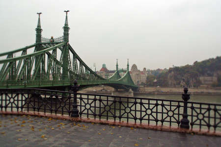 Liberty Bridge or Freedom Bridge also known as the Green Bridge in Budapest in a cloudy raining day.
