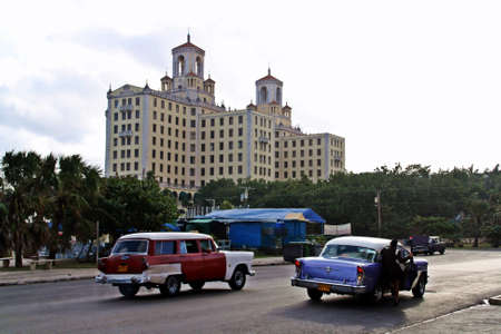 Traffic in a street of the Cuban capital and National Hotel of Cuba Building at the background.