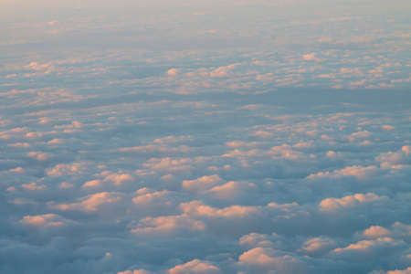 A sea of ?? clouds captured from the window of an airplane.