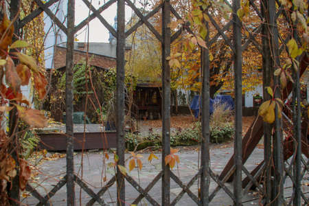 An old house behind rusty bars in the Jewish quarter in Krakow, Poland.