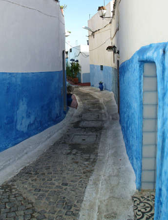Blue and white painted houses in alleyways in the Kasbah of Rabat, Morocco.