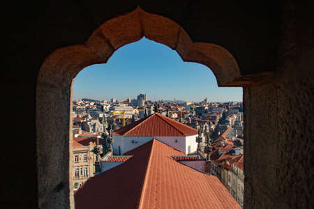 Roof of the Cl�rigos church and aerial view of Porto through a window of the Cl�rigos tower (Portugal).