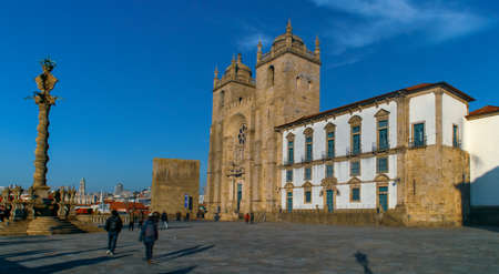Porto / Portugal; 01/21/2017. The esplanade of the Porto Cathedral (in Portuguese, S? do Porto), with the cathedral and the pillory of the cathedral, in Portugal.