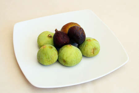 White dish with fresh figs.