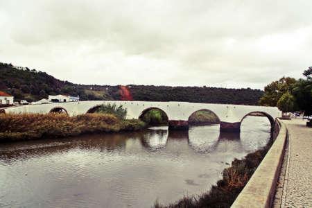 Roman Bridge of Silves over the river Arade, Faro district, Algarve, Portugal.