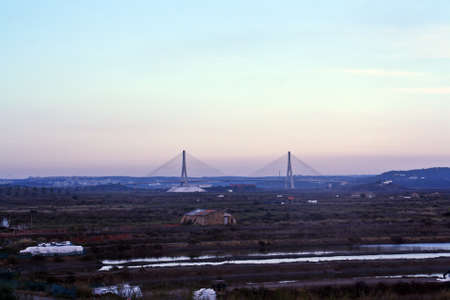 10/21/2015. Marshes of the river Guadiana and International Bridge between Spain and Portugal in Ayamonte (Spain) and Castro Marim (Portugal).