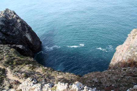Cliff in the South of Portugal, the Atlantic Ocean. Sagres, Algarve, Portugal.