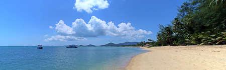 Na Phra Lan beach in Koh Samui. Anchored boats and beach in the island of Koh Samui in Thailand.