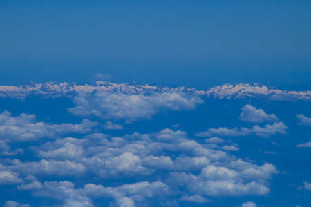The snowy Pyrenees and clouds on its southern side. View ot the mountain range from a commercial flight from the province of Zaragoza.