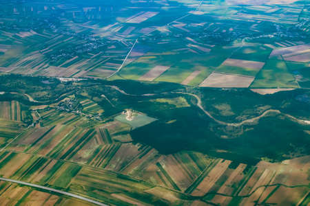 Salcioara village and the Arges river near Bucharest, Romania. Aerial photograph taken from a commercial airplane before landing. Banco de Imagens