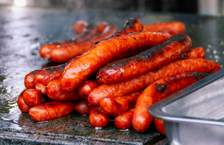 Delicious Romanian sausages being grilled. At a stall next to Bran Castle, Romania.