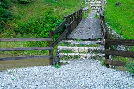 A small wooden bridge over the Turcul river (English: Turkish river) next to Bran Castle in Romania.