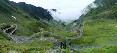 The Transfagarasan or DN7C is the second highest paved road in Romania. Photo of the north side of the mountain, in the valley of the river Balea. Road located in the Carpathian Mountains of Romania.