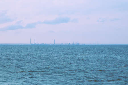 Constanta industrial zone, Petromidia refinery, and the Black Sea in Romania. Views of the coast of Constanta from one of its breakwaters on the beach.