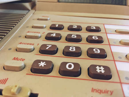 Numeric keypad of an old telephone. Close-up of a vintage telephone.