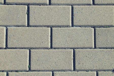 New gray cobblestone floor. Desktop background, floor of a street in the city of Madrid.