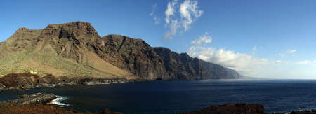 Panoramic landscape of the Giants (Translation: Los Cliffs of the Giants) from Cape Teno in the south of the island of Tenerife. Rocky precipice of great height and beauty, Canary Islands, Spain. Stock Photo