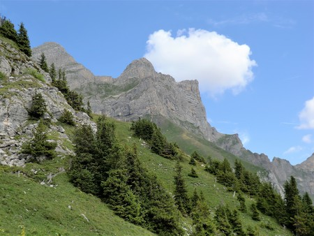 Crags above a steep mountain meadow near Engelberg, Switzerland