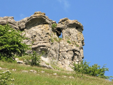 Limestone crags against a blue sky in the Peak District National Park, England
