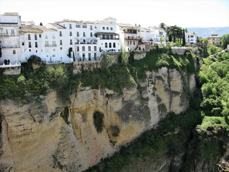 White buildings on the edge of the gorge at Ronda, Andalucia, Spain