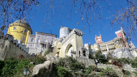 Colourful buildings of Sintra, Portugal, seen from below against a blue sky Stock Photo