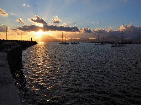 Sunset and sailing boats from the harbour wall at Arrecife, Lanzarote