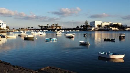 Boats on the natural lagoon at Arrecife, Lanzarote Stock Photo