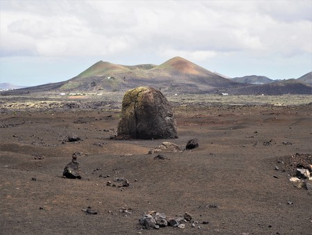 Huge volcanic bomb and volcano in the Timanfaya National Park, Lanzarote