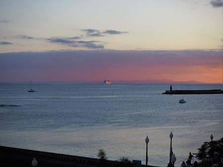 Cruise ship sailing into the sunset from Lanzarote Stock Photo