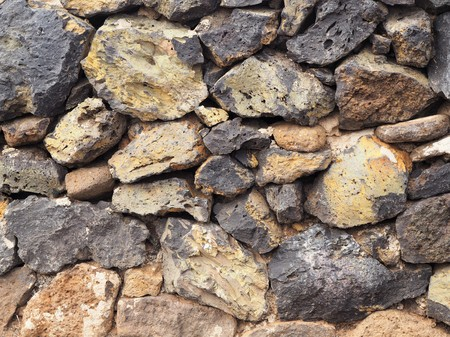 Close up of a stone wall showing colours and textures Stock Photo