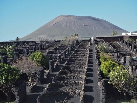 Vineyard and volcano near San Bartolome, Lanzarote Stock Photo