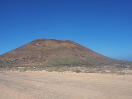 Agujas Grandes volcano with colourful rock strata, La Graciosa, Canary Islands