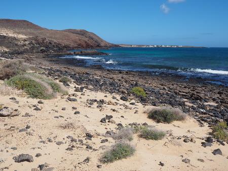 Sandy shore of La Graciosa island with a view of Caleta de Pedro Barba, Canary Islands Stock Photo