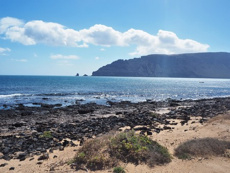 View of Lanzarote from the shore of La Graciosa island in the Canary Islands Stock Photo