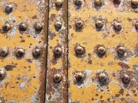 Rivets and rust on a section of an old metal railway bridge Stock Photo