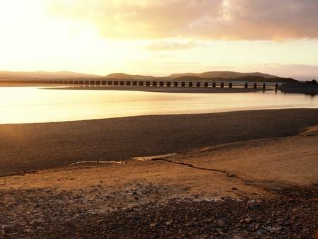 Viaduct over the Kent Estuary at Arnside, Cumbria, England, at sunset Stock Photo
