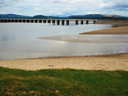 Viaduct over the Kent River estuary at high tide near Arnside, Cumbria