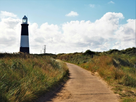 Approaching the lighthouse at Spurn Point, East Yorkshire, England Stock Photo