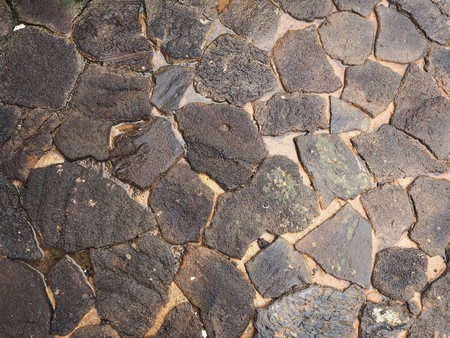 Rough crazy paving stones with standing water