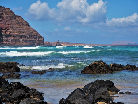 Blue Atlantic waves approaching the volcanic coast near Orzola, Lanzarote