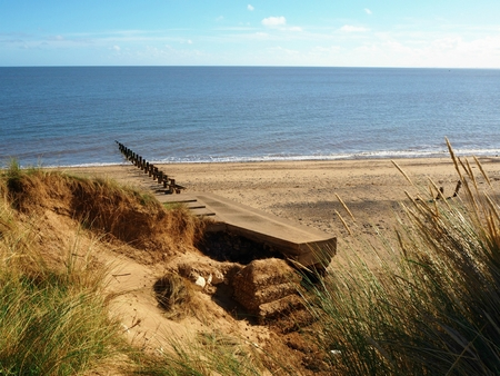 Sandy beach and sea view at Spurn Point nature reserve, East Yorkshire, England Standard-Bild - 114666823